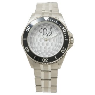 Golf ball, monogram, wristwatch