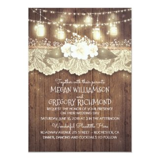 Country Chic Rustic Wedding Invitation with mason jars, string lights and barn wood background
