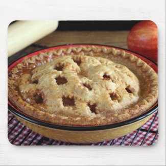 Home baked apple pie on cooling rack with apple mouse pad